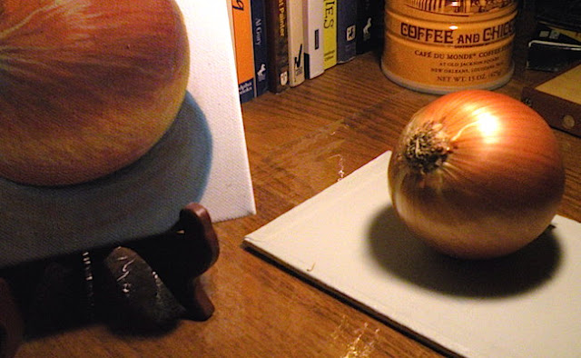 photo of onion still life setup painting