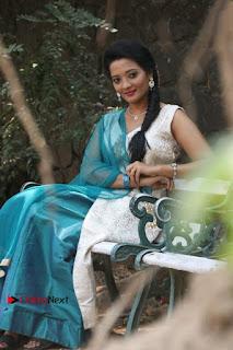 Tamil Actress Koushika Stills in White Salwar Kameez at Inayathalam Tamil Movie Audio Launch  0011.jpg
