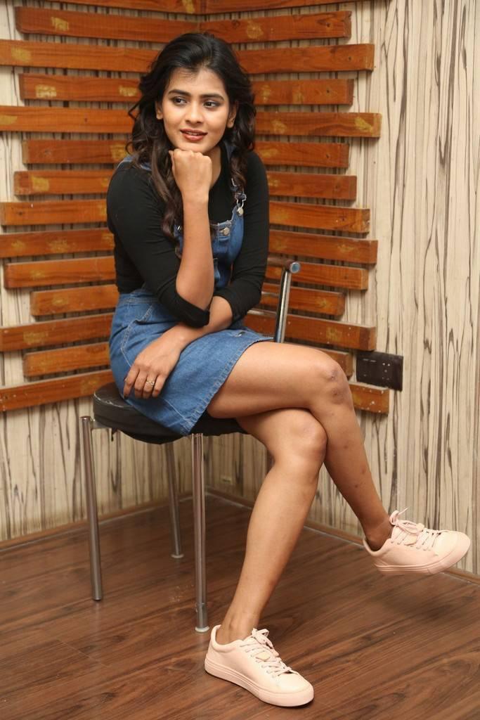 Hebah Patel Stills At Film Interview In Blue Mini Short