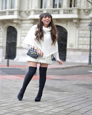 outfit de invierno blanco y negro con botas largas