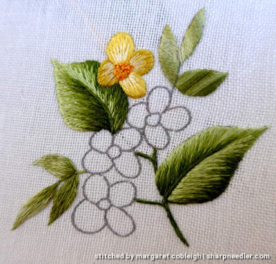 Motif with yellow flowers showing different ways to use variegated House of Embroidery threads on the leaves.