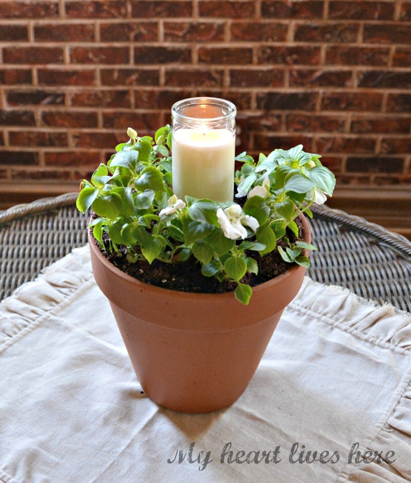 Flower pot candle my heart lives here i spent just under ten dollars at walmart to purchase the two flower pots two 6 packs of flowers and the white candle in glass izmirmasajfo Image collections