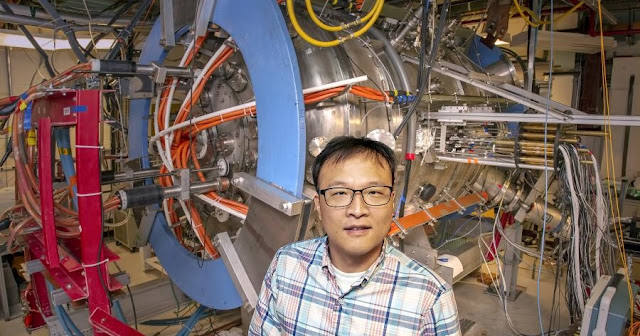 PPPL physicist Jongsoo Yoo stands next to the Magnetic Reconnection Experiment (MRX). Credit: Elle Starkman