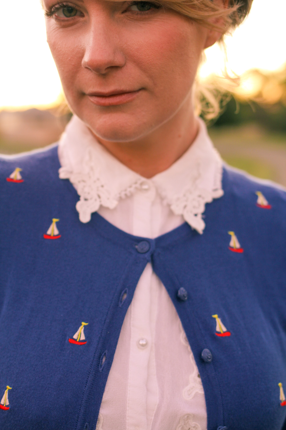 @findingfemme in red Modcloth skirt with embroidered sailboat cardigan from Louie et Lucie