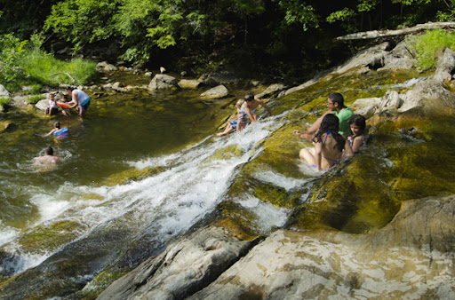Children playing and swimming at Kent Falls waterfall, Kent CT