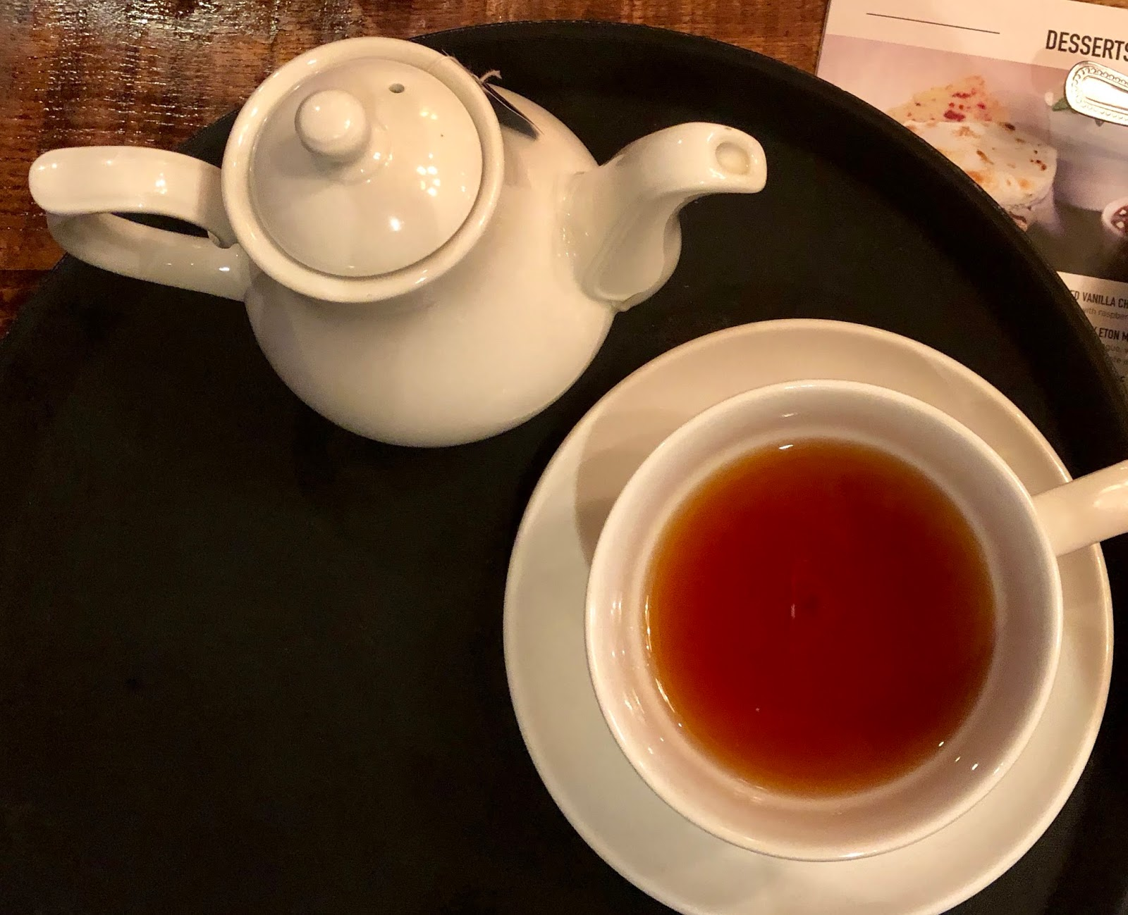 Tea pot and tea cup with earl grey tea
