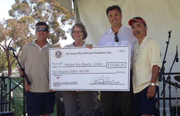 Peter Balantyne, Sherri Lightner, and Ted Pena present a check for $10,000 to support MBAC acceessible watersports