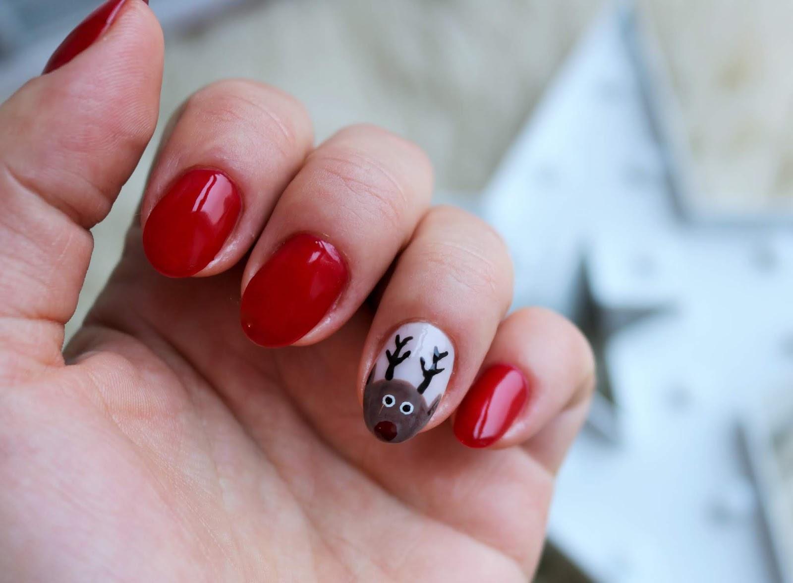 świąteczne zdobienie paznokci renifer