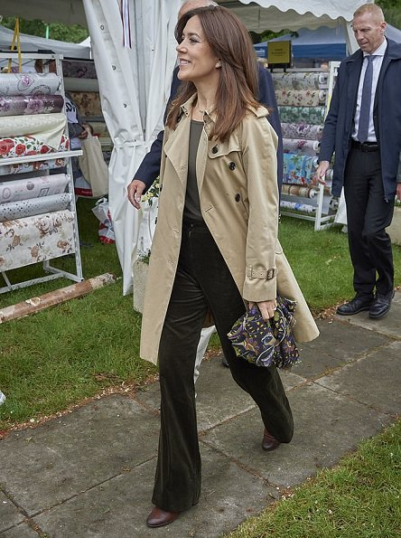 Crown Princess Mary wore a Ralph Lauren double breasted trench coat, a velvet trousers, and a sweater at agricultural and livestock fair
