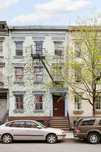 A home for sale in this pastel-colored townhouse on 7th Street