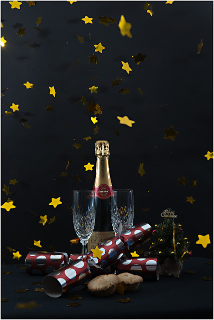 Christmas fizz, mince pies, crackers and starburst
