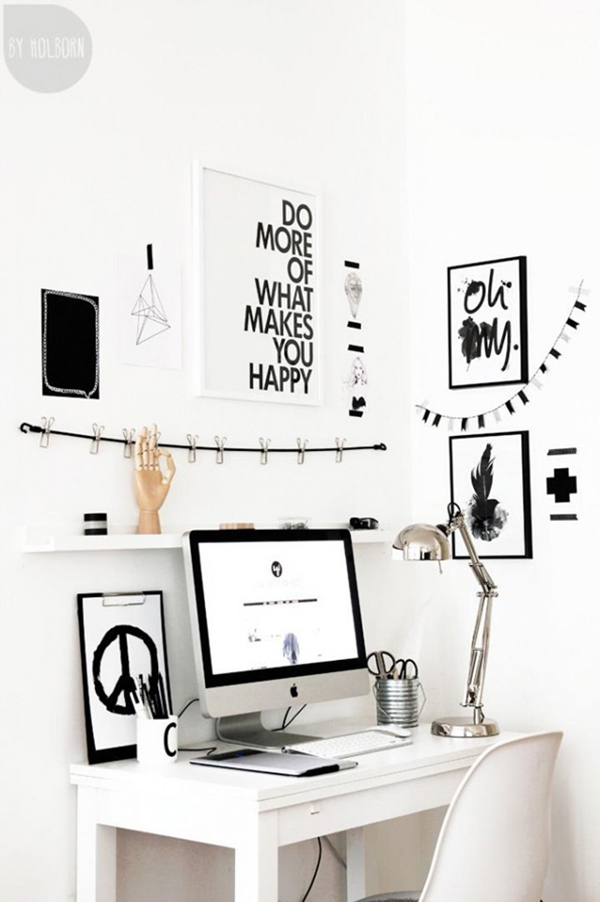 black and white workspace con quadri e citazioni - monitor apple mac