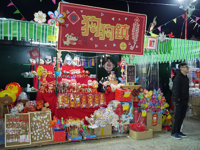 stall selling dog-themed items at Tap Seac Square Lunar New Year Market