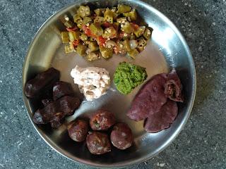 Vinayagar Chathurthi special:  Finger millet dumplings (Ragi Kozhukattai) from left:  Sweet modhaham, Hot Veg, Sweet Sesame jaggery poornam,  Ladies finger curry, Coriander chutney, Coconut chutney