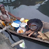 Meet The Woman Who Sells Beans Ball (Akara) From A Boat