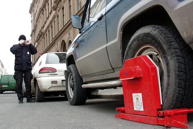 Össze kell hangolni a parkolás szabályait tartalmazó jogszabályokat