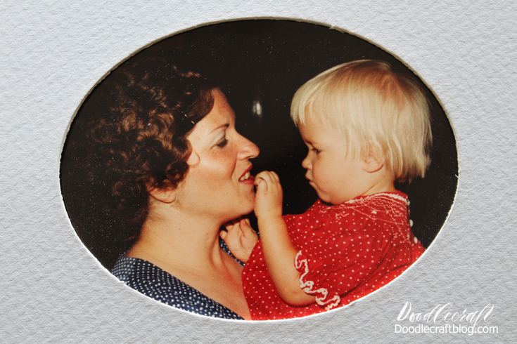 Chubby toddler aged girl with mom, both dressed up in bright polka dots in profile looking at each other lovingly.