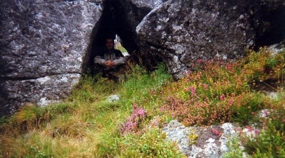 a cave under a large boulder