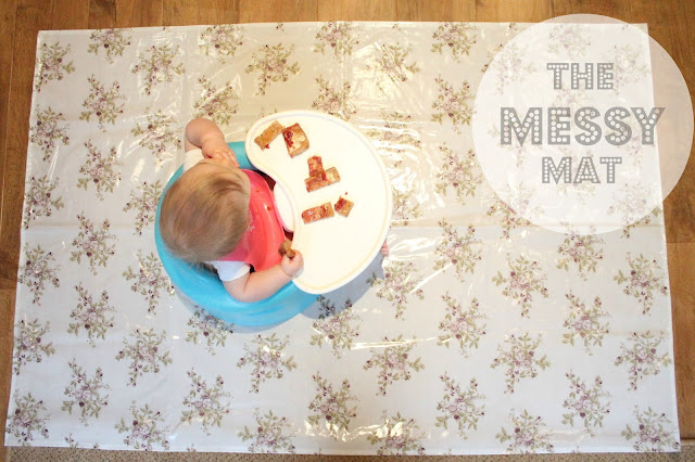 image looking down on baby eating with chair on the messy mat review header image