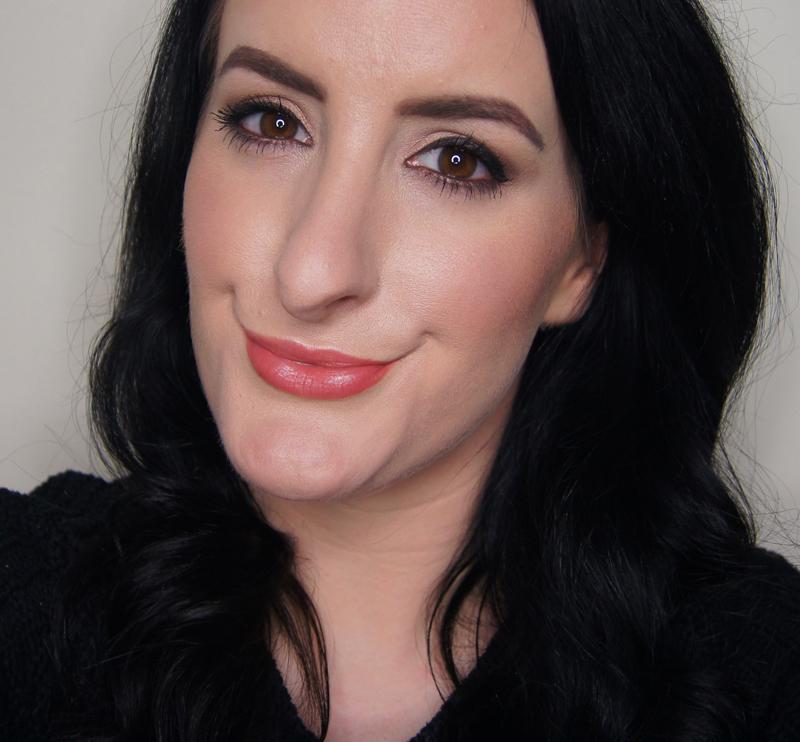 pretty glowing spring makeup look fresh dewy skin cat eye liner flick highlighted cheeks glossy peach lip