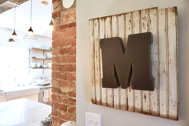 M wooden sign hanging in kitchen