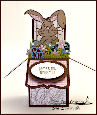 North Coast Creations Stamp Set: Hippity Hoppity, North Coast Creations Custom Dies: Bunny, Our Daily Bread Designs Paper Collection: Blushing Rose, Shabby Rose, Our Daily Bread Designs Custom Dies: Surprise Box, Flower Box Fillers, Grass Lawn, Grass Hill, Pierced Ovals, Mini Tags and Labels, Easter Eggs