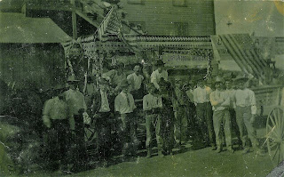 Group of men posed beside a union float in Thurber