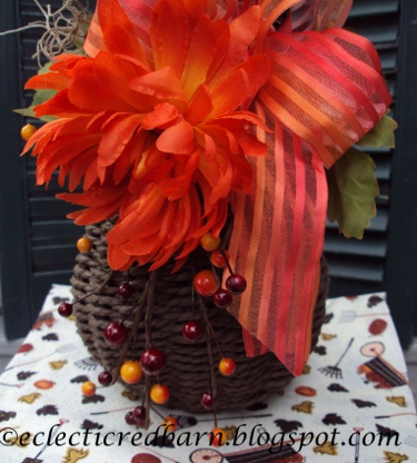 Eclectic Red Barn: Berries, mum, and ribbon attached to wicker vase