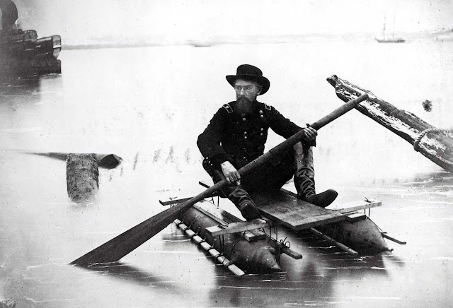 Union General Herman Haupt, a civil engineer, moves across the Potomac River in a one-man pontoon boat that he invented for scouting and bridge inspection in an image taken between 1860 and 1865. Haupt, an 1835 graduate of West Point, was chief of construction and transportation of U.S. military railroads during the war.