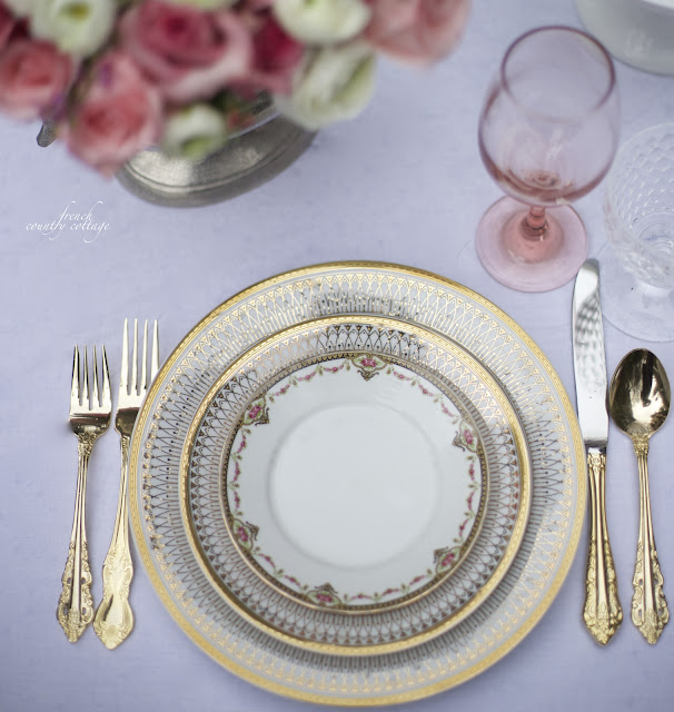 Gold dishes with vintage plates and gold flatware
