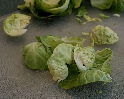 Four Ways to Cut Up Brussels Sprouts, depending on how you'll use them ♥ AVeggieVenture.com. Step-by-step photos.