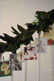Use old Christmas pictures and cards with garland to decorate a railing