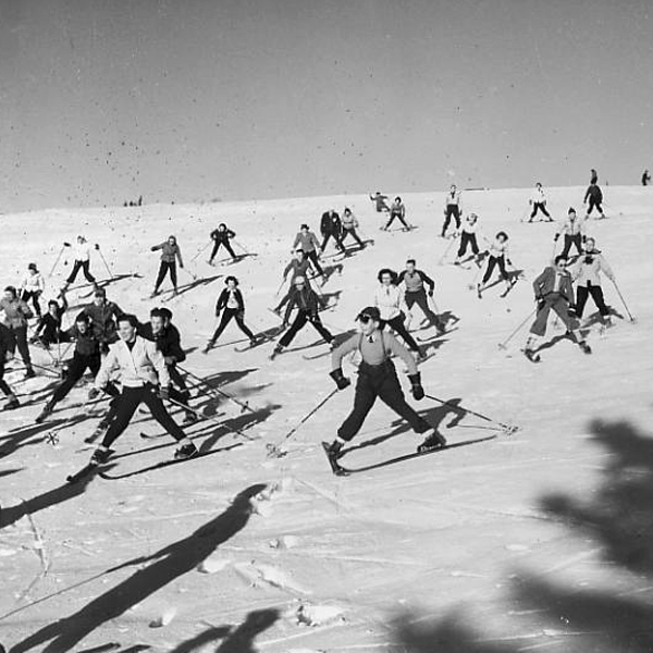 skiers snowplowing down a hill, 1940's