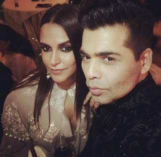 Karan Johar and Neha Dhupia was busy to take selfie in the party.