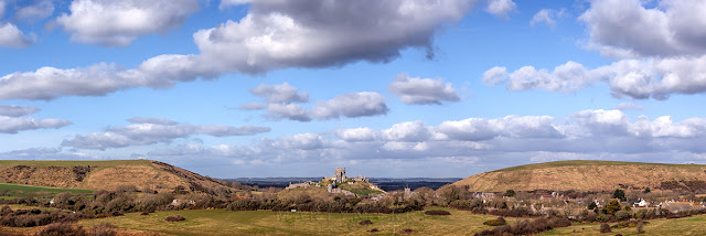 Corfe Castle between East and West hill in a panorama from Dorset
