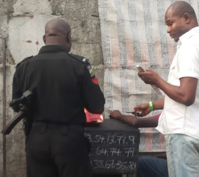 nigerian policeman playing baba ijebu lotto