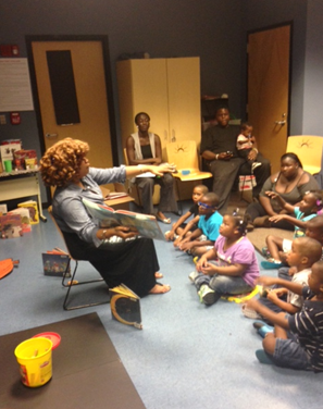 BPL employee reads to kids and parents