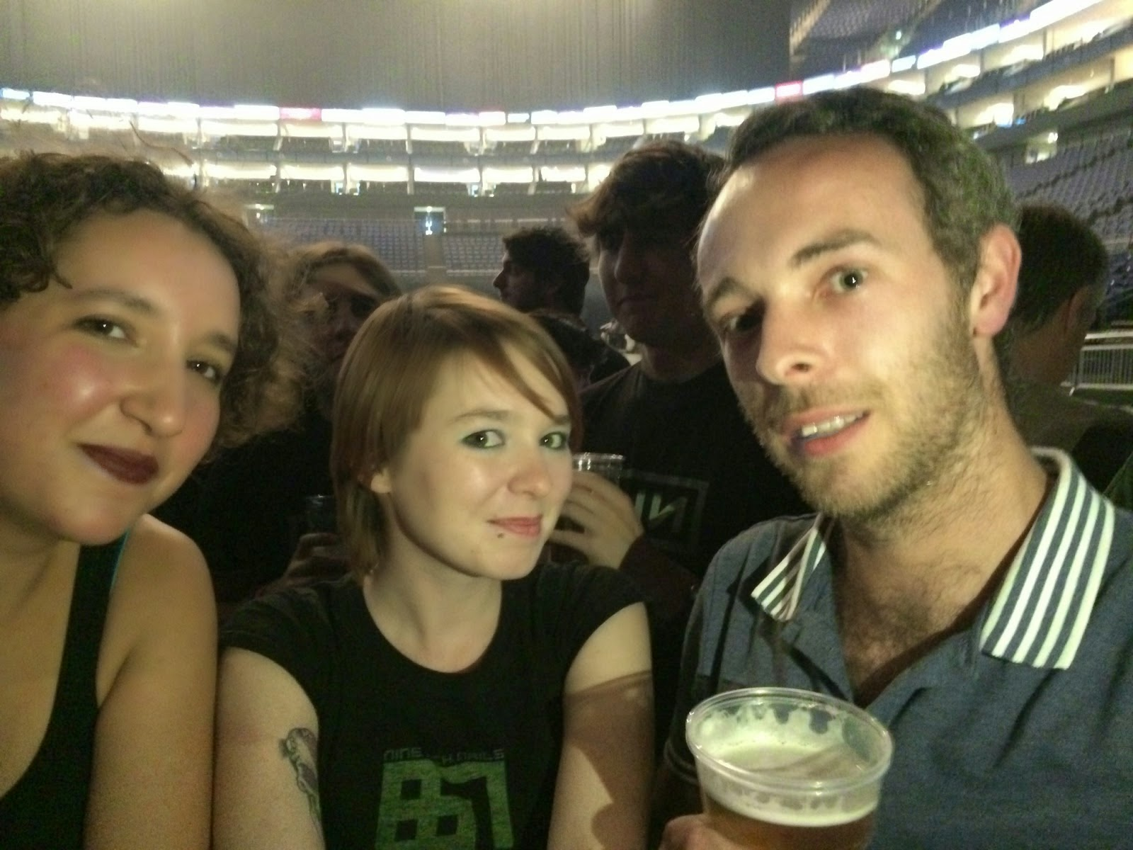 three people front row o2 arena