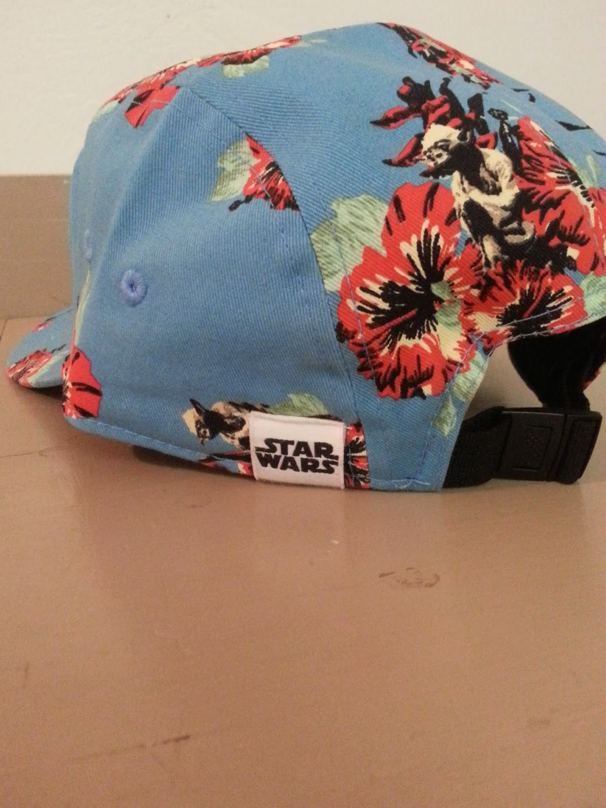 d9e7ae2a9a The adjustable hat is blue with a leather Vans logo patch on the front and  a Star Wars tag on the back.You can find it at Vans stores