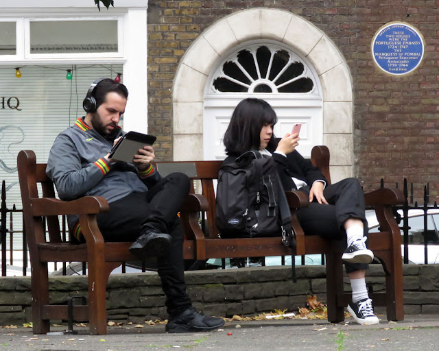 On a bench in Golden Square, Soho, London