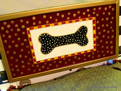 hand painted dog bone wooden plaque with dots and stripes