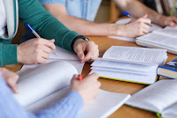 Students taking notes from textbooks (Credit: Shutterstock) Click to Enlarge.