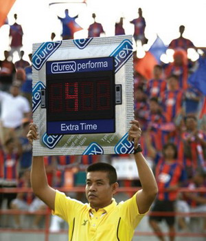 Fourth official holds up a massive electronic condom aloft