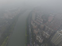 Residential buildings are seen in smog during a polluted day in Nanjing, Jiangsu province, March 19, 2016. (Credit: Reuters/Stringer) Click to Enlarge.