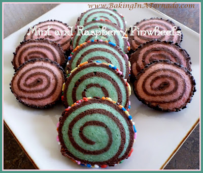Mint and Raspberry Pinwheels, these cookies are as flavorful as they are beautiful. Perfect for holidays but a favorite treat for any day. | Recipe developed by www.BakingInATornado.com | #recipe #bake #cookies