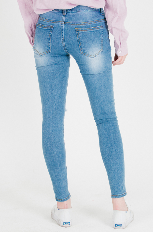 Slit Knee Faded Wash Skinny Jeans