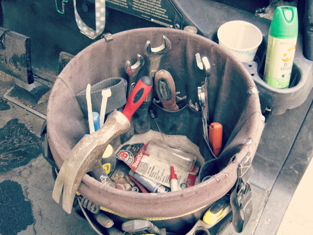 tools in a bucket hammer wrench construction