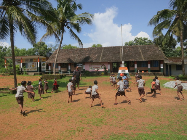 Playing with kids in a village school