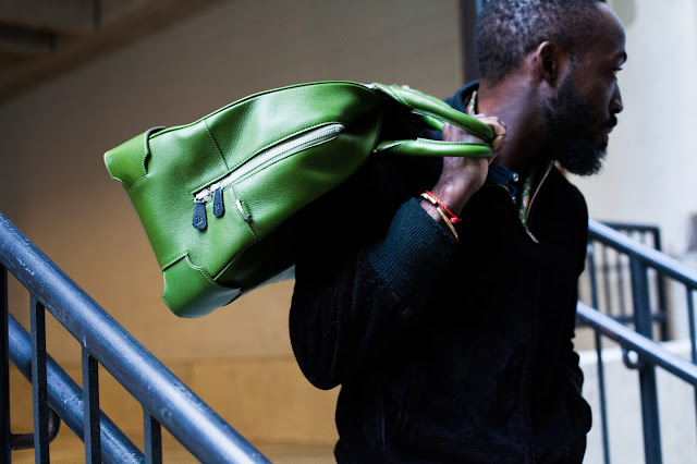 man with arch bowling bag