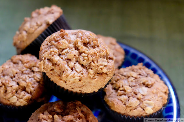 a stack of whole wheat pear and pecan streusel muffins on a plate